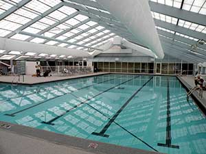 Geothermal humidity control system in indoor pool room